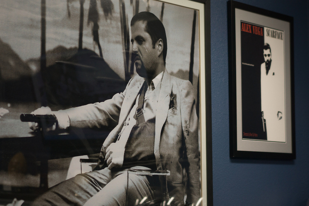 DORAL, FLORIDA, DECEMBER 11, 2015<br /> A couple of posters of the movie Scarface with Alex Vega replacing Al Pacino on the walls of the office of Vega, owner of The Auto Firm, a South Florida car customizing and restoring shop which has a vast clientele of professional athletes and entertainers. His office walls are full of mementos given to him and signed by his clients.<br /> (Photo by Angel Valentin/Freelance)