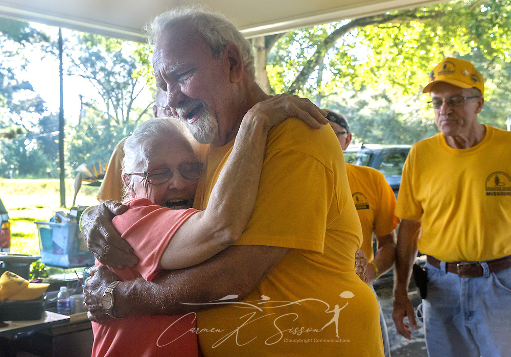 Homeowner Fay McDowell, of Zoar Baptist Church, hugs SBDR volunteer Gary Tracy, a member of Northern Hills Baptist Church in Holt, Mo., following a prayer meeting at her house, Aug. 22, 2016, in Baton Rouge, La. McDowell is one of thousands of Louisiana residents whose homes were damaged by floods last week. Tracy, along with other SBDR volunteers from Missouri, is helping tear out sheetrock and spray funigicide to prevent mold from growing. (Photo by Carmen K. Sisson)