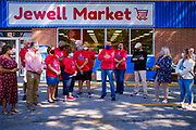 "03 AUGUST 2020 - JEWELL, IOWA:  GARREN ZANKER, manager of the Jewell Market, center, talks about the community efforts to reopen the grocery store during the grand opening Monday. The only grocery store in Jewell, a small community in central Iowa, closed in 2019. It served four communities within a 20 mile radius of Jewell. Some of the town's residents created a cooperative to reopen the store. They sold shares to the co-op and  held fundraisers through the spring. Organizers raised about $225,000 and bought the store, which had its ""soft opening"" July 8. The store celebrated its official reopening Monday August 3. Before the reopening, Jewell had been a ""food desert"" for seven months. The USDA defines rural food deserts as having at least 500 people in a census tract living 10 miles from a large grocery store or supermarket. There is a convenience store in Jewell, but it sells mostly heavily processed, unhealthy snack foods that are high in fat, sugar, and salt.          PHOTO BY JACK KURTZ"