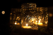 Simple lanterns made of mason jars, sand, and tea lights provide just enough illumination for the area surrounding the reception tent at the wedding of Ariana Rockefeller on Mount Desert Island, Maine, Saturday, September 4, 2010.  Craig Dilger for The New York Times