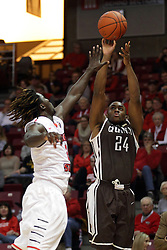 27 November 2015: Godson Eneogwe shoots for 3 over Quintin Brewer (2). Illinois State Redbirds host the Quincy Hawks at Redbird Arena in Normal Illinois (Photo by Alan Look)