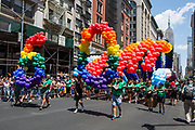 "New York, NY - 30 June 2019. The New York City Heritage of Pride March filled Fifth Avenue for hours with participants from the LGBTQ community and it's supporters. The rainbow arch of ballons was preceded by the number ""50"" in a tall balloon arrangement."