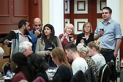 © Licensed to London News Pictures . 02/05/2019. Bolton, UK. Agents and candidates watch the count and drink coffee . The count for Bolton Council at Bolton Town Hall . The Labour Party are threatened to lose their majority on the council . Local council elections are taking place across the country . Photo credit: Joel Goodman/LNP