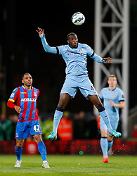 Yaya Toure of Manchester City is challenged by Jason Puncheon of Crystal Palace - Photo mandatory by-line: Rogan Thomson/JMP - 07966 386802 - 06/04/2015 - SPORT - FOOTBALL - London, England - Selhurst Park - Crystal Palace v Manchester City - Barclays Premier League.
