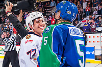 REGINA, SK - MAY 23: Matt Bradley #77 of the Regina Pats shakes hands with Artyom Minulin #5 of the Swift Current Broncos at the Brandt Centre on May 23, 2018 in Regina, Canada. (Photo by Marissa Baecker/CHL Images)