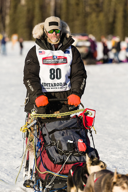 Musher Billy Snodgrass competing in the 44th Iditarod Trail Sled Dog Race on Long Lake after leaving the restart on Willow Lake in Southcentral Alaska.  Afternoon. Winter.