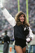 A Los Angeles Raiders cheerleader performs during the NFL football game between the Bufalo Bills and the Oakland Raiders on December 8, 1991 in Los Angeles, California. The Bills won the game 30-27. ©Paul Anthony Spinelli