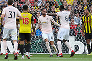 GOAL - Manchester United Defender Chris Smalling is congratulated by Manchester United Midfielder Paul Pogba during the Premier League match between Watford and Manchester United at Vicarage Road, Watford, England on 15 September 2018.