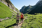 Hiking in Meglisalp up Rotsteinpass, in the Alpstein limestone mountain range, Appenzell Alps, Switzerland, Europe. Appenzell Innerrhoden is Switzerland's most traditional and smallest-population canton (second smallest by area). For licensing options, please inquire.