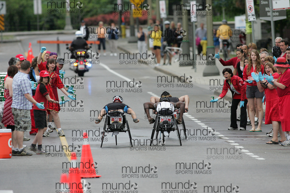 (Ottawa, ON --- May 30, 2010) Wheelchair athletes make their way through a water station in the first half of the 2010 Ottawa marathon duringduring the Ottawa Race Weekend. Photograph copyright Sean Burges / Mundo Sport Images