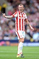 """Stoke City's Glenn Whelan during the Barclays Premier League match at the Britannia Stadium, Stoke-on-Trent. PRESS ASSOCIATION Photo. Picture date: Sunday August 9, 2015. See PA story SOCCER Stoke. Photo credit should read: Martin Rickett/PA Wire. EDITORIAL USE ONLY. No use with unauthorised audio, video, data, fixture lists, club/league logos or """"live"""" services. Online in-match use limited to 45 images, no video emulation. No use in betting, games or single club/league/player publications."""