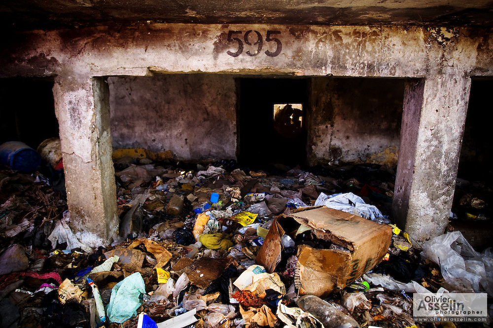 The house number is seen above the main entrance of a home almost entirely buried in garbage in the Medina Gounass neighborhood of Guediawaye, Senegal on Friday May 1, 2009. (Olivier Asselin for the New York Times).