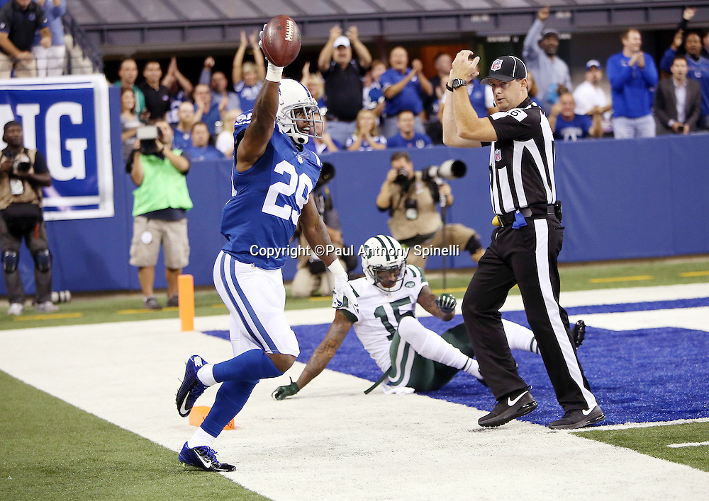Side judge Allen Baynes (56) signals reception as Indianapolis Colts strong safety Mike Adams (29) holds the ball in the air in celebration after intercepting a deep pass intended for New York Jets wide receiver Brandon Marshall (15) in the second quarter during the 2015 NFL week 2 regular season football game against the New York Jets on Monday, Sept. 21, 2015 in Indianapolis. The Jets won the game 20-7. (©Paul Anthony Spinelli)