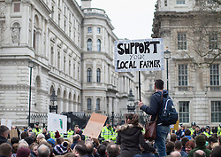 © Licensed to London News Pictures. 23/03/2016. London, UK. Farmers demonstrate opposite Downing Street in support of the farming sector. Photo credit: Peter Macdiarmid/LNP
