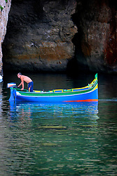 MALTA GOZO DWEJRA 22JUL06 - Fishermen arrive back at the Inland Sea, a landlocked body of seawater connected to the Mediterranean via a tunnel in the towering cliff face. ..jre/Photo by Jiri Rezac..© Jiri Rezac 2006..Contact: +44 (0) 7050 110 417.Mobile: +44 (0) 7801 337 683.Office: +44 (0) 20 8968 9635..Email: jiri@jirirezac.com.Web: www.jirirezac.com