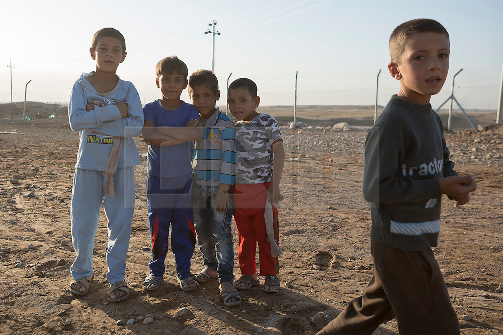 Licensed to London News Pictures. 22/10/2016. Young Iraqi refugees are seen at the Dibaga refugee camp near Makhmur, Iraq.<br /> <br /> The crowded Dibaga camp, housing around 28,000 Sunni Arab refugees, is the main gathering point for new IDPs now fleeing areas where ISIS have been pushed out or are in conflict with the Iraqi Army. Photo credit: Matt Cetti-Roberts/LNP