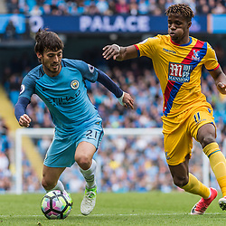 Manchester City midfielder David Silva (21) on the ball tracked by Crystal Palace midfielder Wilfried Zaha (11)<br /> in the English Premier League match between Manchester City and Crystal Palace<br /> (c) John Baguley | SportPix.org.uk