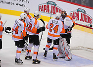 Dec. 3 2011; Glendale, AZ, USA; Philadelphia Flyers congratulate goalie Ilya Bryzgalov (30) after defeating the Phoenix Coyotes 4-2 at Jobing.com Arena. Mandatory Credit: Jennifer Stewart-US PRESSWIRE.