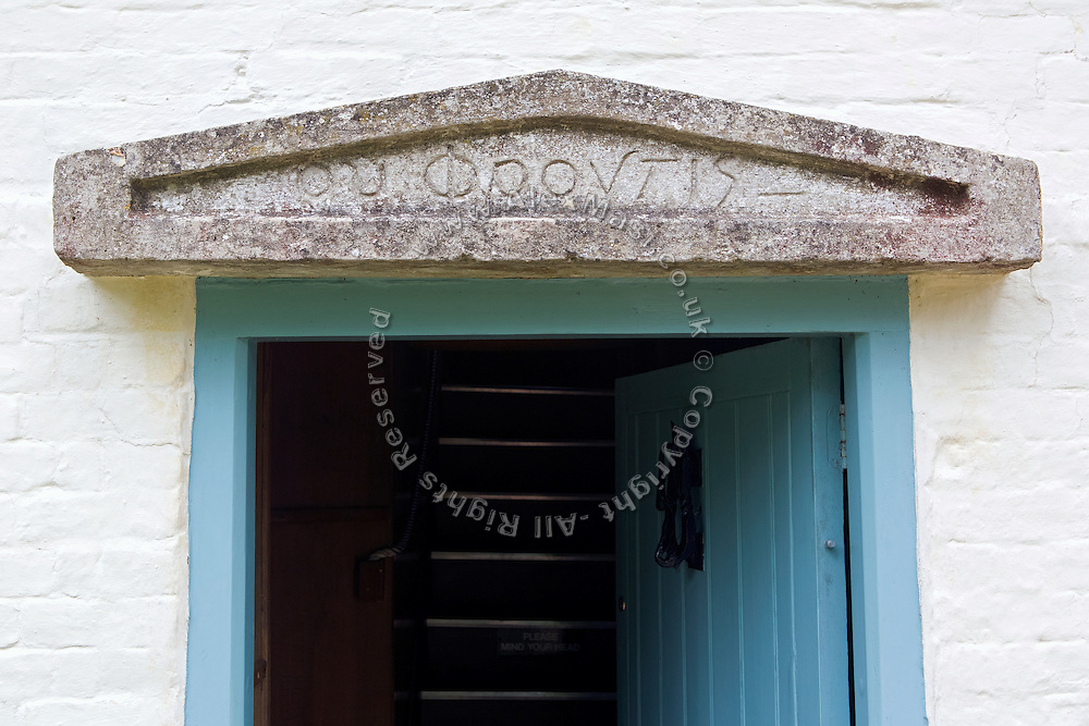 "The greek words 'Ou Phrontis' ('Who cares?') are inscripted above the door of the former home of T. E. Lawrence, (""Lawrence of Arabia"") Clouds Hill, near Wool, Dorset, southwest England."
