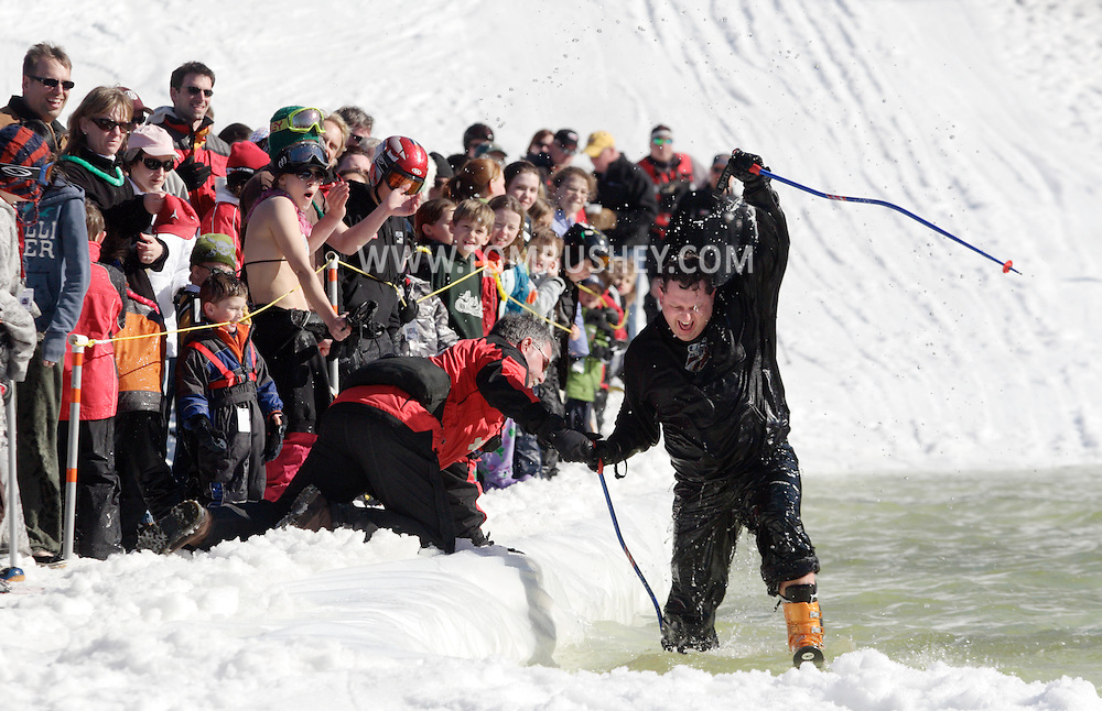 Warwick, NY - A wet skier is helped out of the water after falling while trying to ski across the water at the Spring Rally at Mount Peter in Warwick on March 29, 2008.