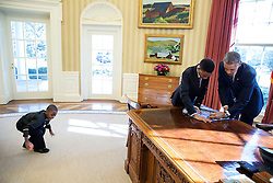 "President Barack Obama signs a poster for 13-year-old student Vidal Chastanet, who appeared on the ""Humans of New York""  blog, as his 6-year-old brother Alden St. Marie plays at left in the Oval Office, Feb. 5, 2015. (Official White House Photo by Pete Souza)<br /> <br /> This official White House photograph is being made available only for publication by news organizations and/or for personal use printing by the subject(s) of the photograph. The photograph may not be manipulated in any way and may not be used in commercial or political materials, advertisements, emails, products, promotions that in any way suggests approval or endorsement of the President, the First Family, or the White House."