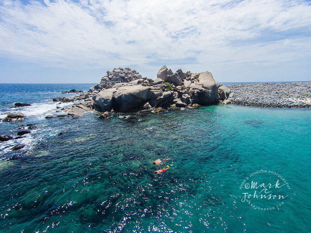 Couple snorkeling at Cabo Pulmo, Gulf of California, Baja California Sur, Mexico people ****Model Release available