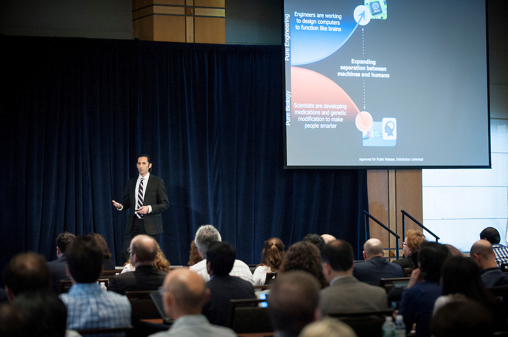 "Dr. Justin Sanchez, a program manager in the Biological Technologies office at DARPA, delivers a keynote address at DARPA's ""Biology Is Technology"" symposium in New York City on June 23, 2015. The two-day event was held by DARPA's Biological Technologies Office to bring together leading-edge technologists, start-ups, industry, and academic researchers to look at how advances in engineering and information sciences can be used to drive biology for technological advantage."
