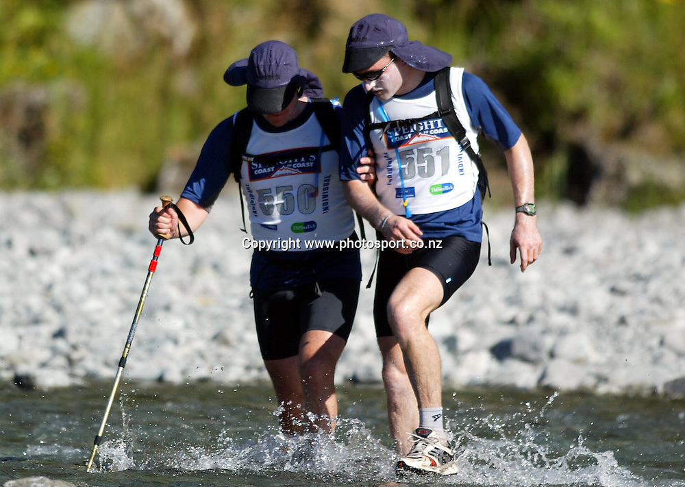 Blind competitor Mark Pollock from Ireland with guide James O'Callaghan cross the river during the Speight's Coast to Coast Endurance Race from Kumara through to Sumner, Christchurch on Friday 4th February, 2005.<br />PHOTO: Hannah Johnston/PHOTOSPORT