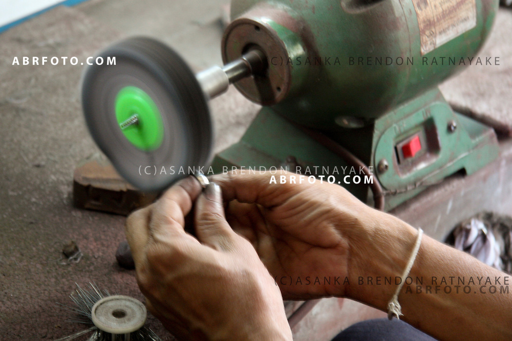 A Gem maker shines gems on a lathe