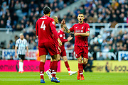 Dejan Lovren (#6) of Liverpool in conversation with Virgil van Dijk (#4) of Liverpool during the Premier League match between Newcastle United and Liverpool at St. James's Park, Newcastle, England on 4 May 2019.