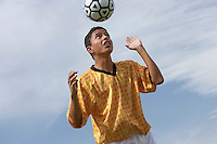 Soccer Player Heading a Ball