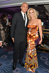 WES BROWN and his wife at the Caudwell Children's annual Butterfly Ball held at The Grosvenor House Hotel, Park Lane, London on 15th May 2014.