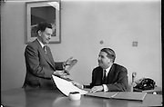 04/02/1964<br /> 02/04/1964<br /> 04 February 1964<br /> Esso Film Award and Esso Directors at Esso offices, Stillorgan, Dublin. Image shows Mr J.M. Donovan (left) and Mr Brendan Martin, Directors Esso, admiring the Esso Film Award.