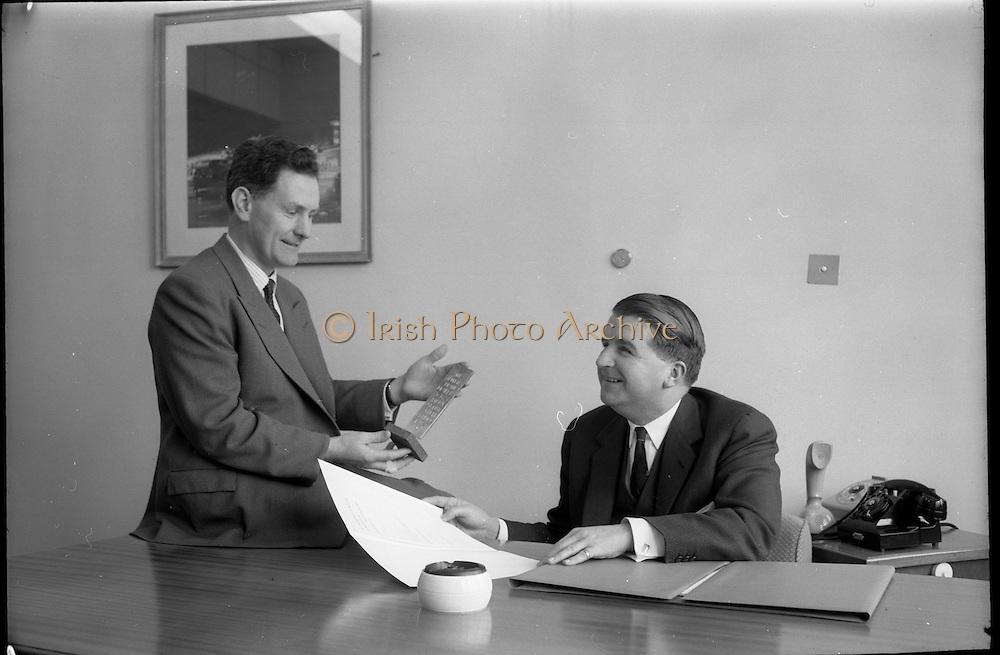 04/02/1964<br /> 02/04/1964<br /> 04 February 1964<br /> Esso Film Award and Esso Directors at Esso offices, Stillorgan, Dublin. Image shows Mr J.M. Donovan (left) and Mr Brendan Martin, Directors Esso, admiring the Esso Film Award.
