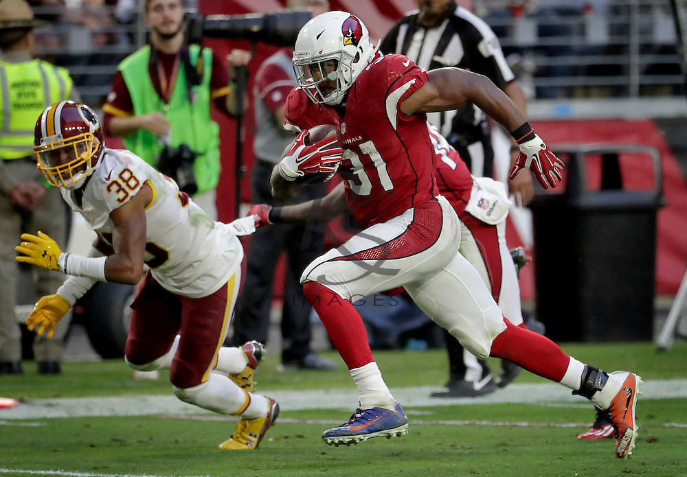 Arizona Cardinals running back David Johnson (31) runs for a touchdown as Washington Redskins cornerback Kendall Fuller (38) defends during the second half of an NFL football game, Sunday, Dec. 4, 2016, in Glendale, Ariz. (AP Photo/Rick Scuteri)