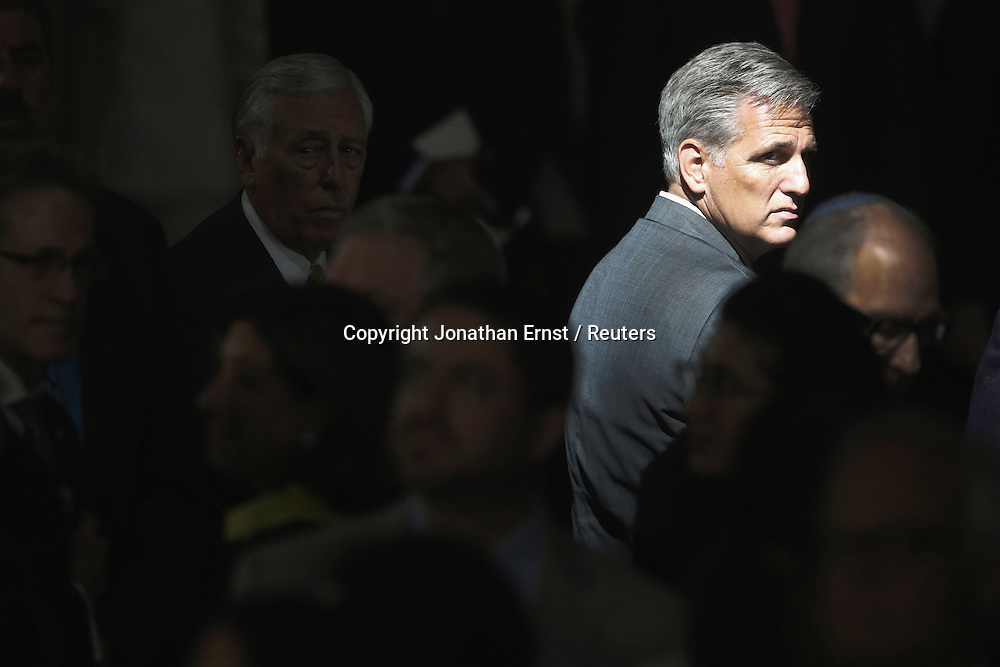 Days after he ascended to House Minority Leader, Rep. Kevin McCarthy (R-CA) stands in a shaft of light during a Congressional Gold Medal ceremony in the rotunda of the U.S. Capitol.
