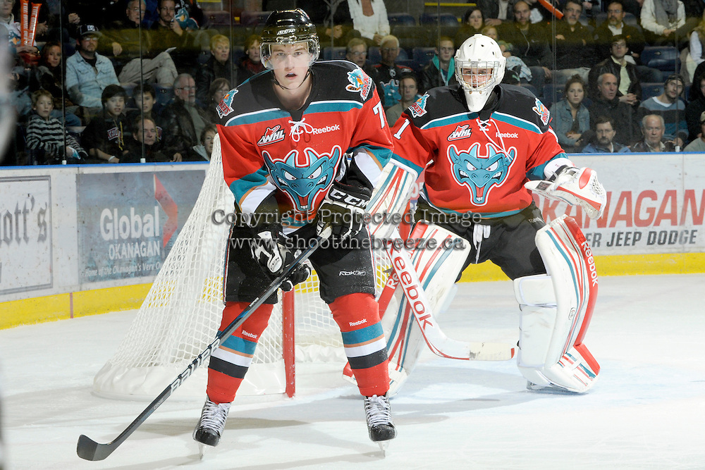 KELOWNA, CANADA, OCTOBER 26: Damon Severson #7 and Adam Brown #1 of the Kelowna Rockets keep their eye on the puck as the Prince George Cougars visit the Kelowna Rockets   on October 26, 2011 at Prospera Place in Kelowna, British Columbia, Canada (Photo by Marissa Baecker/Shoot the Breeze) *** Local Caption *** Damon Severson; Adam Brown;