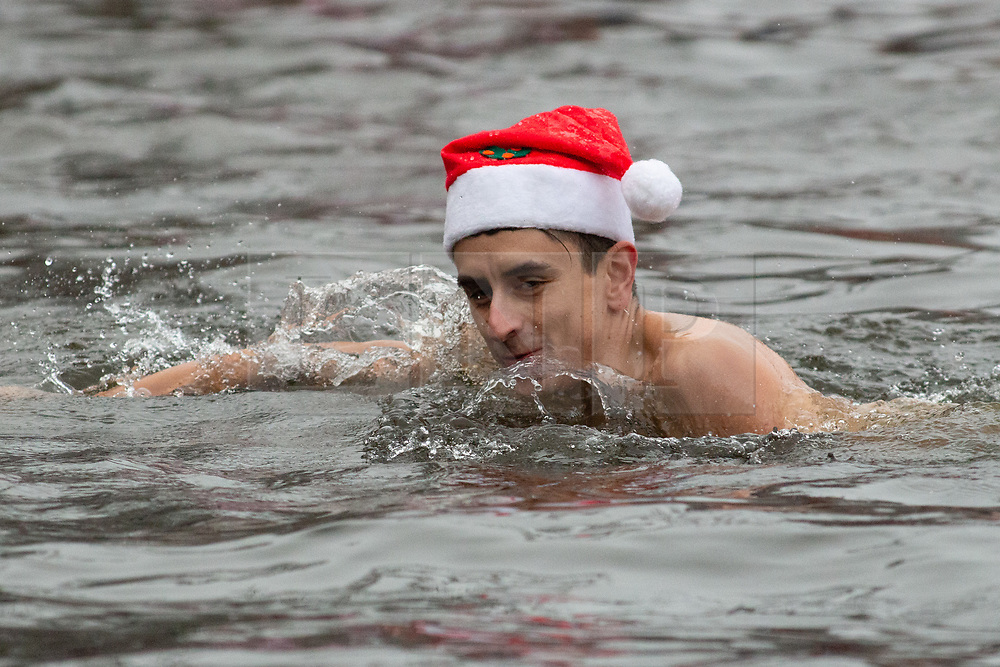 © Licensed to London News Pictures. 25/12/2018. Sutton Coldfield, West Midlands, UK. Christmas Day swim, Blackroot pool, Sutton Coldfield, West Midlands. The Christmas Day swim has become an annual tradition with swimmers of all ages taking part in the early morning chilly festive dip. Participants arrive from 9am to get ready for the plunge into the water at 10am. Photo credit: Dave Warren/LNP