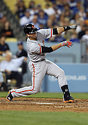 LOS ANGELES, CA - APRIL 6:  Buster Posey #28 of the San Francisco Giants loses his bat as it flies into the fan seats during the game against the Los Angeles Dodgers at Dodger Stadium on Sunday, April 6, 2014 in Los Angeles, California. The Dodgers won the game 6-2. (Photo by Paul Spinelli/MLB Photos via Getty Images) *** Local Caption *** Buster Posey