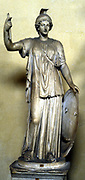 Minerva: Ancient Roman goddess of wisdom, patroness of arts, wearing helmet and holding shield. Athene in Greek pantheon. Statue.