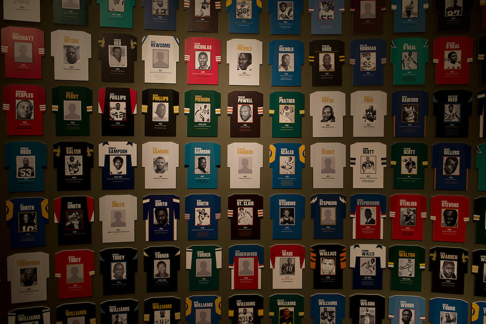 A wall displaying former Grambling State University football players who have gone on to careers in the NFL at the Eddie G. Robinson Museum in Grambling, Louisiana on October 23, 2013.  (Cooper Neill for The New York Times)