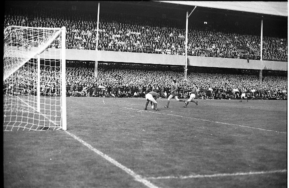 Waterford FC vs Manchester United at Lansdowne Road..1968..18.09.1968..09.18.1968..18th September 1968..Waterford FC as champions of the league of Ireland drew Manchester United, the European Champions,in the first round of this years competition.The Waterford team was as follows: Peter Thomas, Peter Bryan, Noel Griffin, Vinny Maguire, Jackie Morley, Jimmy McGeough, Al Casey, Alfie Hale, John O'Neill, Shamie Coad and Johnny Matthews. Manchester United won the tie 3 -1 with Denis Law being the man of the match..Alex Stepney,Tony Dunne,Francis Burns,Paddy Crerand,.Bill Foulkes,Nobby Stiles,George Best,Denis Law,.Bobby Charlton,David Sadler,Brian Kidd were the starting eleven for United...Image shows Alex Stepney taking contol of the situation during the match.