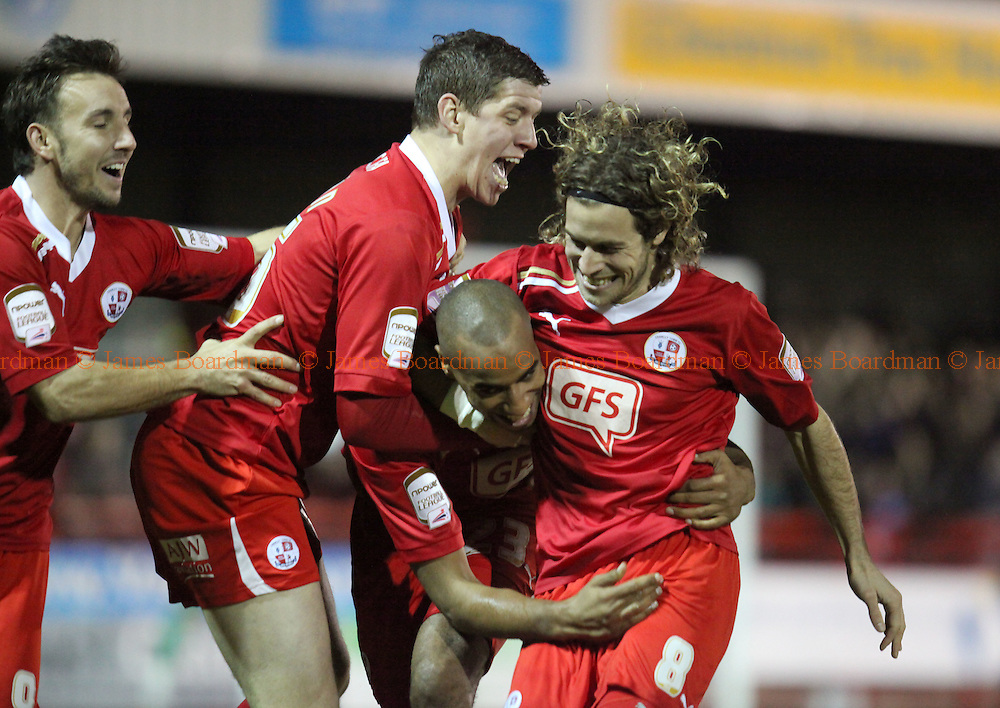 JAMES BOARDMAN / 07967642437.Crawley's Tyrone Barnett [3rd L]celebrates scoring the opener with Matt Tubbs, Glenn Wilson and Sergio Torres during the NPower league 2 match between Crawley Town and Barnet at the Broadfield Stadium in Crawley. December 30, 2011.