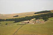 Peak District farmhouse and fields in high summer, near Castleton, Debyshire peak district national park England