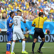 Claudio Marchisio of Italy is shown a red card for a high, studs up challenge on Uruguay's Egidio Arevalo during the 2014 FIFA World Cup match at Arena das Dunas, Natal<br /> Picture by Stefano Gnech/Focus Images Ltd +39 333 1641678<br /> 24/06/2014