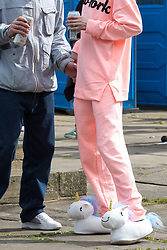 © Licensed to London News Pictures . 02/09/2017 . Keighley , UK . An EDL protester wearing unicorn slippers and pink sweatpants and sweatshirt at the demonstration . Far-right street protest movement , the English Defence League ( EDL ) , hold a demonstration in the West Yorkshire town of Keighley , opposed by anti-fascists , including Unite Against Fascism ( UAF ) . The EDL say they are demonstrating against the sexual grooming and abuse of English girls by Muslim men and against terrorism across the UK . Photo credit : Joel Goodman/LNP