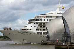 © Licensed to London News Pictures. 03/07/2016. The World residential cruise ship has arrived in Greenwich, London. MS The World is a residence at sea, carrying wealthy passengers around the world who own apartments on board. The ship, which was launched in 2002, has 165 apartments.  As well as six restaurants, the World has a large lobby, gourmet deli and grocery store, a boutique and showroom, fitness center, billiard room, golf simulator and putting greens, a full-sized tennis court, jogging track, a spa, swimming pool, and cocktail lounge. The World last visited London in 2013. Credit: Rob Powell/LNP