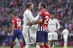 February 9, 2019 - Madrid, Madrid, Spain - Sergio Ramos of Real Madrid and Godin of Atletico de Madrid in action during La Liga Spanish championship, , football match between Atletico de Madrid and Real Madrid, February 09th, in Wanda Metropolitano Stadium in Madrid, Spain. (Credit Image: © AFP7 via ZUMA Wire)