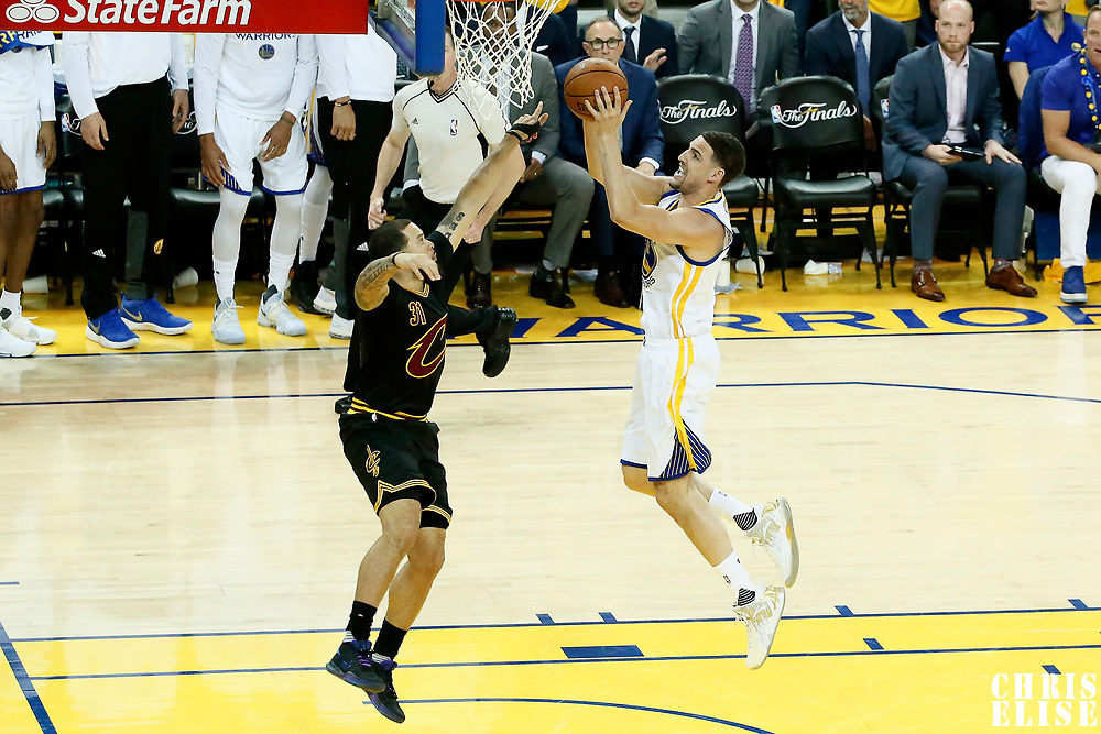 12 June 2017: Golden State Warriors guard Klay Thompson (11) goes for the layup past Cleveland Cavaliers guard Deron Williams (31) during the Golden State Warriors 129-120 victory over the Cleveland Cavaliers, in game 5 of the 2017 NBA Finals, at the Oracle Arena, Oakland, California, USA.