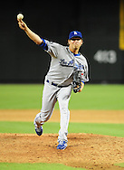 Aug. 6 2011; Phoenix, AZ, USA; Los Angeles Dodgers pitcher Matt Guerrier (55) delivers a pitch against the Arizona Diamondbacks at Chase Field. The Dodgers defeated the Diamondbacks 5-3.  Mandatory Credit: Jennifer Stewart-US PRESSWIRE..